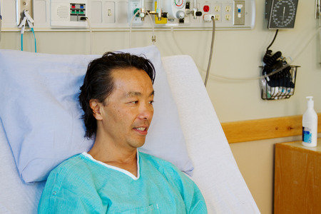 Patient in hospital bed deep in thought photo