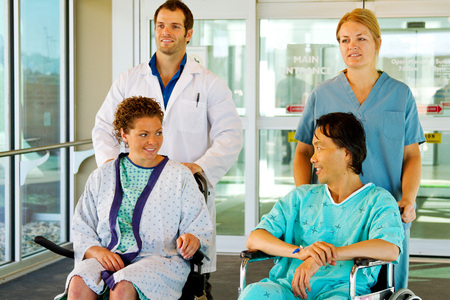 Two hospital staff taking patients for walk