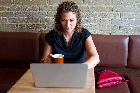 Woman enjoying coffee and computer