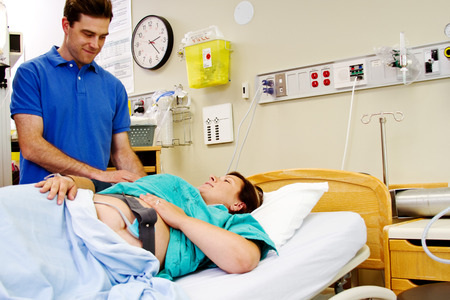 hospitalized: Hospitalized labor patient giving husband a smile