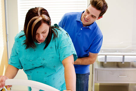 pain: Husband checking if labor pain has subsided Stock Photo