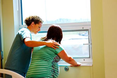 Nurse providing support to Mom in labor Stock Photo