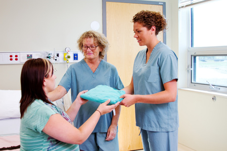 Nurses giving instructions to maternity patient photo