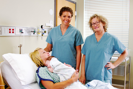 Obstetric nurses in hospital with Mom and newborn