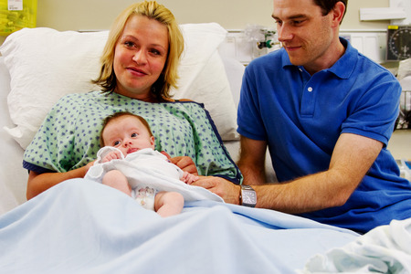 delivery room: Proud parents of new born baby