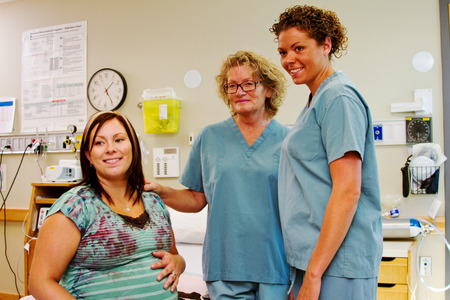 Two nurses with labor patient in hospital Stock Photo