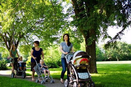 Moms walking in park with children