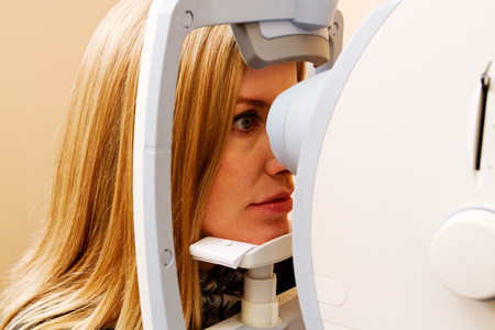 Woman having eye examination completed at optomologist clinic Stock Photo