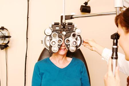 Close up of senior having eye examination at optometry clinic