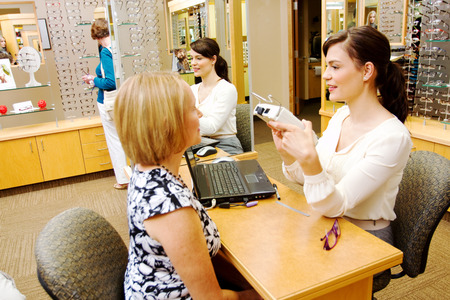 Optician checking a final check for measuring for glasses