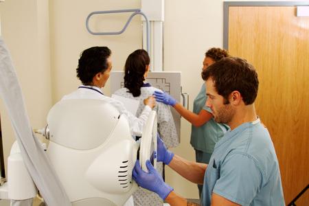 x ray machine: Patient having chest x-ray Stock Photo