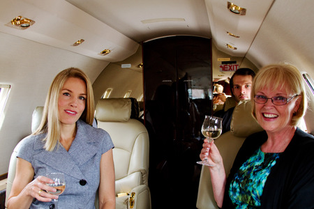 Three passengers relaxing in a private jet
