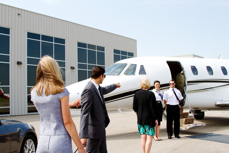 Airline staff outside jet waiting for passengers