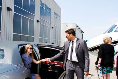 chauffeur: Lady arrives in limo for travel in private jet