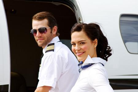 Pilot and stewardess entering jet plane