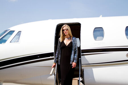 famous people: Diva walking down steps of plane