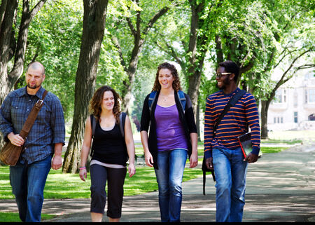 Four University students walking and chatting photo