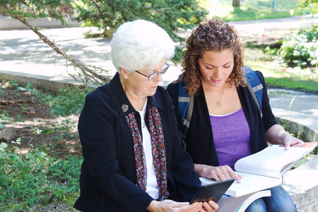 college professor: Professor giving student one on one instruction Stock Photo