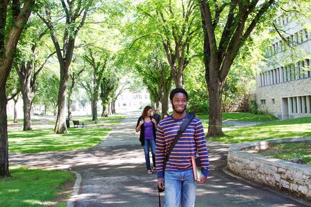 University students visiting while walking
