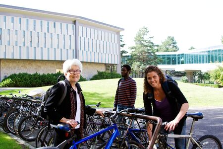 Three University students unlocking bikes