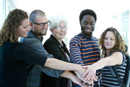 instructor: Four students and tutor with hands together
