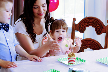 blowing out: Excited child after blowing out candle Stock Photo
