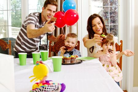 Family birthday party with cupcakes and ballons Stock Photo