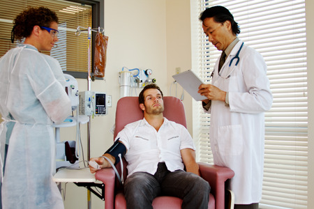 Doctor reviewing care for patient