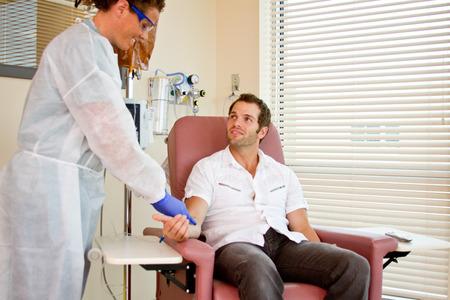 providing: Nurse and patient conversing when nurse providing care