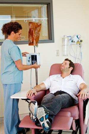 Chemotherapy patient giving nurse a smile