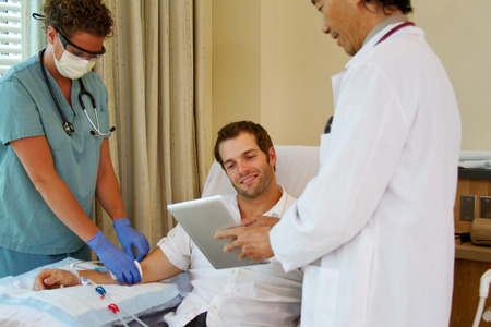 Patient is pleased with test results that doctor is showing him photo