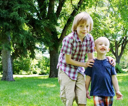Two brothers at park in summer