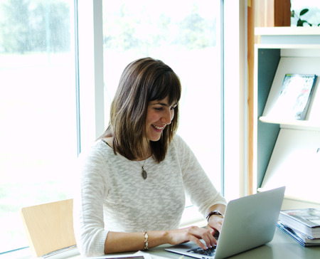 Lady smiling and working at computer