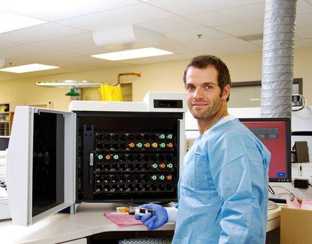 healthcare facilities: Laboratory technician in hospital with blood culture specimen