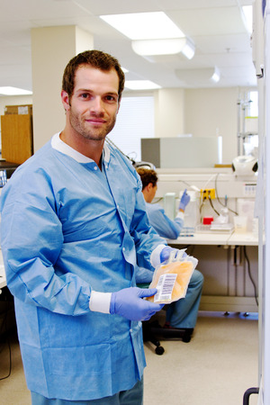 Laboratory technician taking plasma from blood bank at hospital