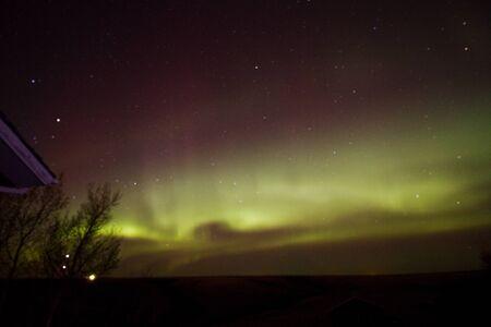 Northern lights and stars on the horizon