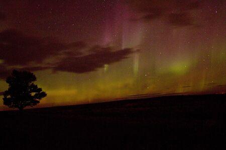 Colorful northern lights on a dark sky Фото со стока