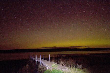 Northern lights with pier in foreground