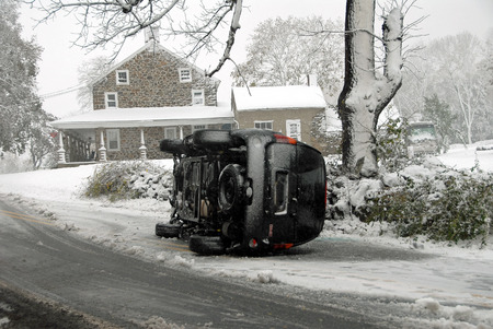 porch scene: Car Flipped on Icy Road