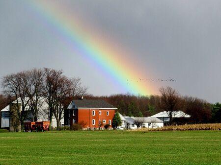 Rainbow over farmland               Stock Photo