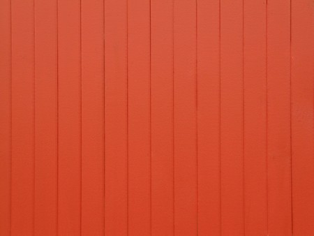 Solid painted orange wooden wall texture background