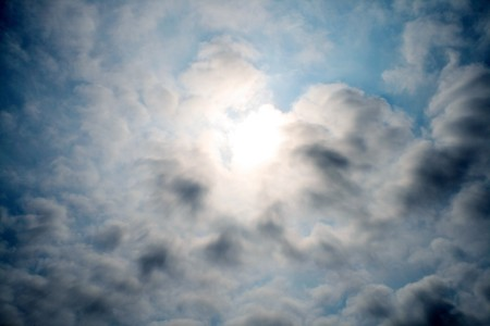 Clouds coverimg the sun abstract background Stock Photo