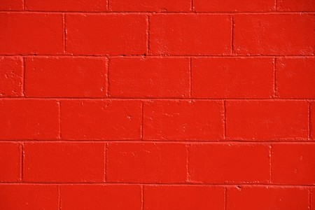 concrete blocks: Closeup of orange painted brick wall Stock Photo