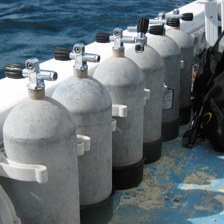 Steel scuba tanks on the dive boat