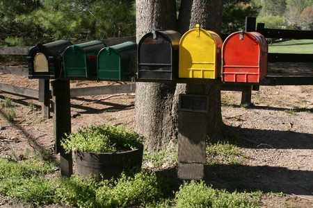 Line of colorful mailboxes on a rural postal route
