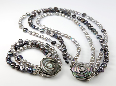 Neckless and bracelet made of fresh water pearls