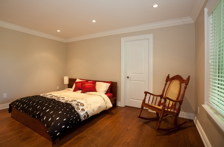 Bedroom with a rocking chair Stock Photo