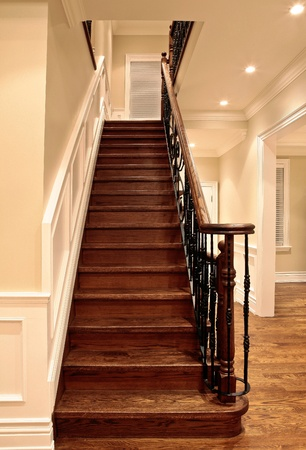 wall decor: Elegant oak stairs in luxury house Stock Photo
