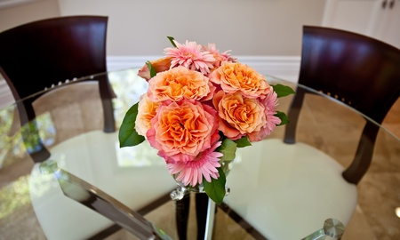 Glass table with flower arrangement Stock Photo