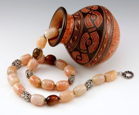 Semi-precious stone necklace on the graded background